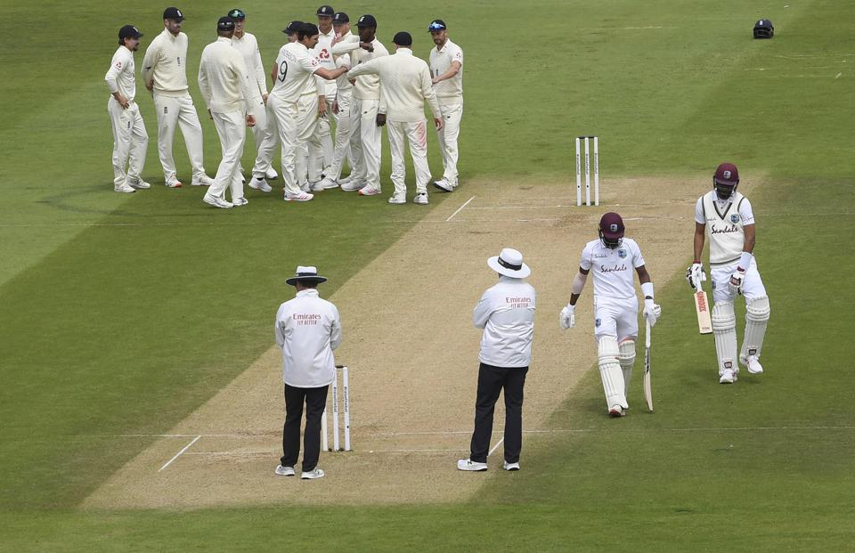 Southampton : England's James Anderson, without cap, celebrates with teammates the dismissal of West Indies' Shamarh Brooks during the third day of the first cricket Test match between England and West Indies, at the Ageas Bowl in Southampton, England, Friday, July 10, 2020. AP/PTI(AP10-07-2020_000201A) (AP)