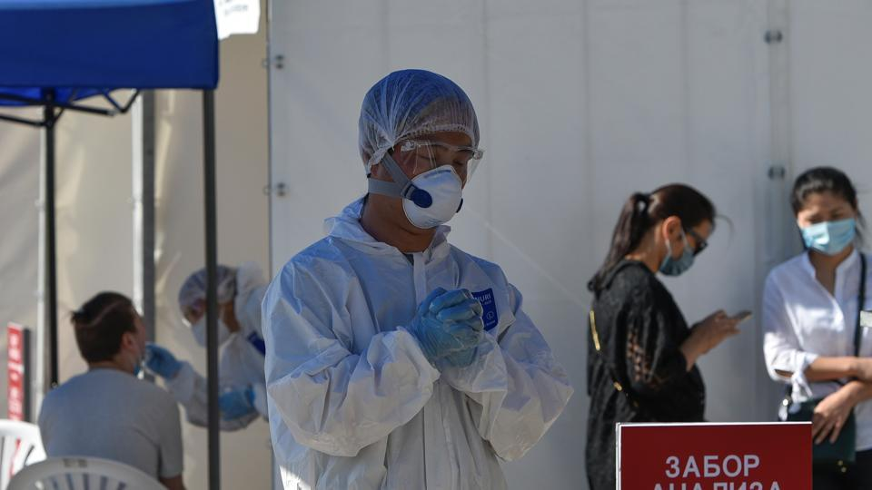Medical specialists wearing protective equipment work at the coronavirus disease (COVID-19) testing facility in Almaty, Kazakhstan July 8, 2020.
