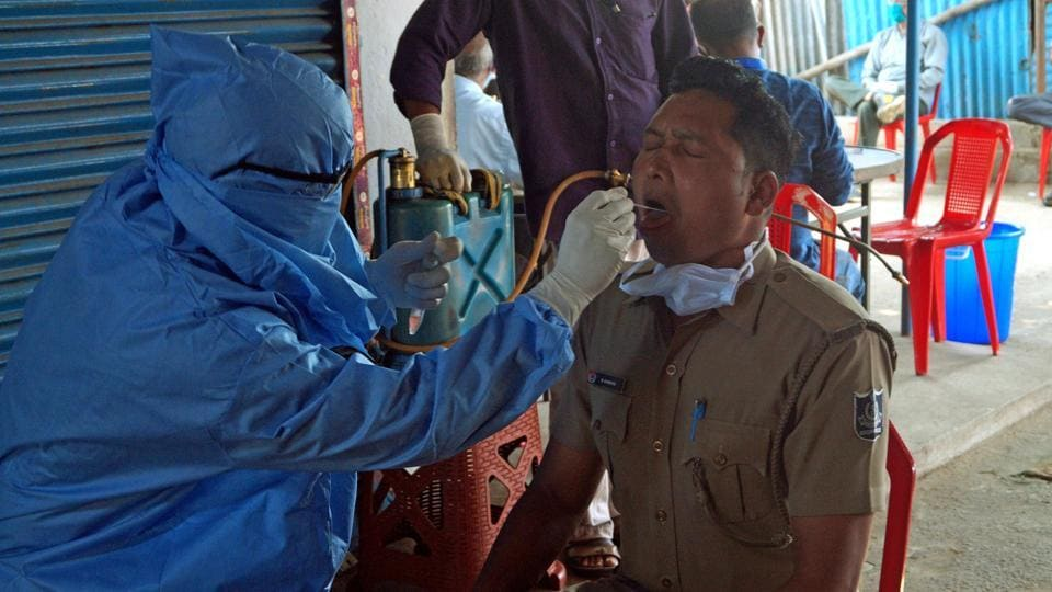 Odisha, Apr 20 (ANI): A health worker collect swab sample of a police personnel for COVID-19 test during ongoing nationwide lockdown to curb the spread of coronavirus (COVID-19) pandemic, in Bhubaneswar on Thursday. (ANI Photo)
