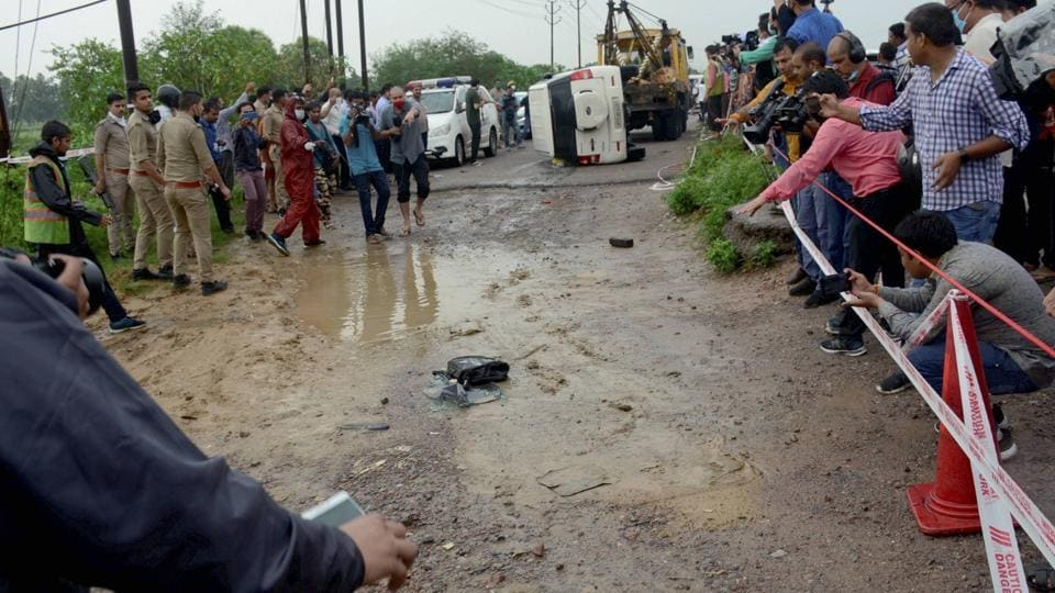 Police and media at the encounter site where gangster Vikas Dubey was killed when he allegedly tried to escape from the spot following an accident, near Kanpur.