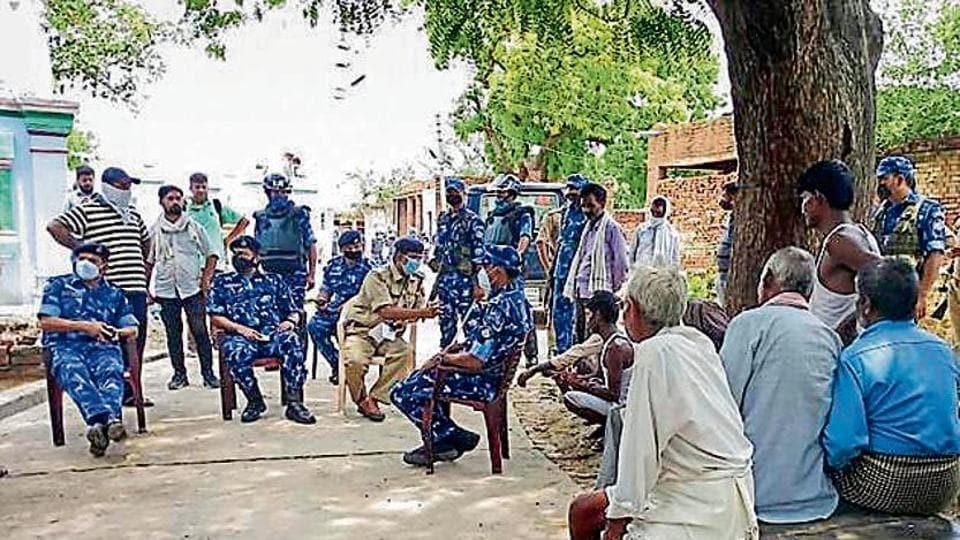 Security forces in Vikas Dubey's Bikru village on Saturday.