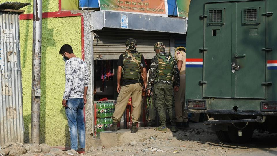 Security forces personnel examine the spot where BJP leader Sheikh Waseem Bari and his family members were killed by the militants, outside their residence in Bandipora district of north Kashmir, on July 8.