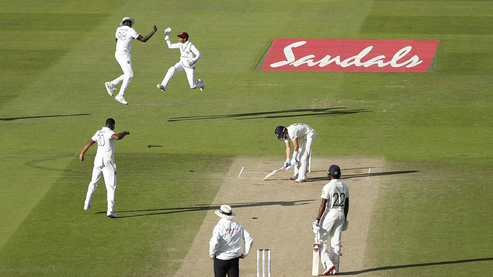 West Indies players celebrates the dismissal of England's Dom Bess, second right, during the fourth day of the first cricket Test match between England and West Indies, at the Ageas Bowl in Southampton, England, Saturday, July 11, 2020. (Adrian Dennis/Pool via AP) (AP)