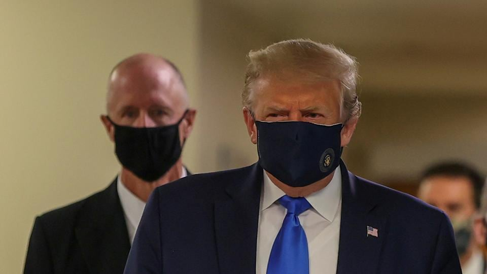 The American president had refused to wear a mask in public, triggering a political war about facial coverings