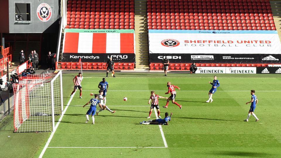 Sheffield United's David McGoldrick scores their third goal.