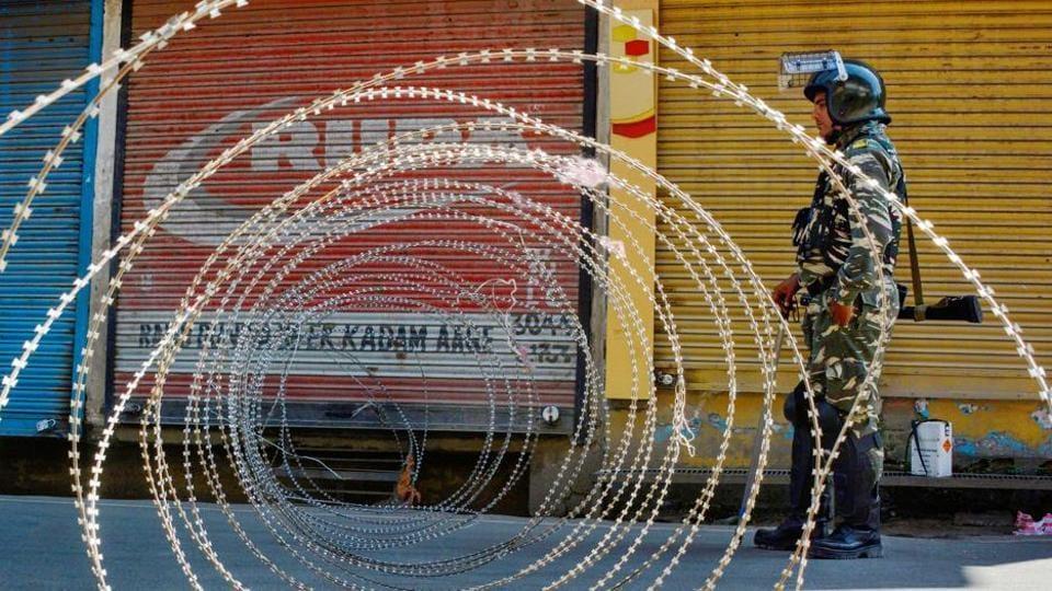 Srinagar: A security person stands guard at a blocked road in Srinagar.