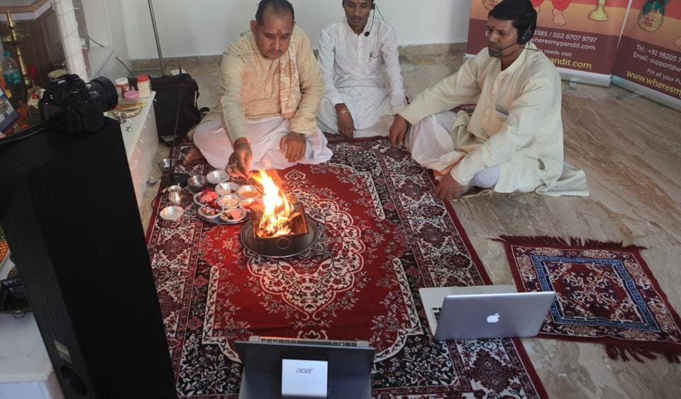 Pandits perform virtual puja as the need for social distancing compels many temples to remain closed during the pandemic.