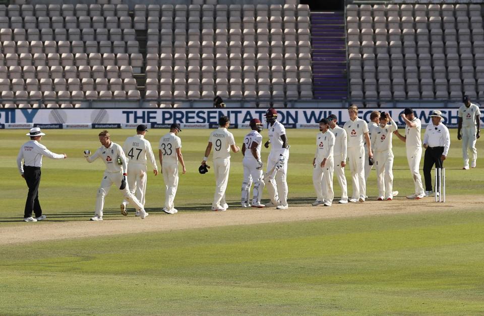 West Indies batsmen, center, greet England players after winning the first cricket Test match between England and West Indies, at the Ageas Bowl in Southampton, England, Sunday, July 12, 2020. (Adrian Dennis/Pool via AP) (AP)