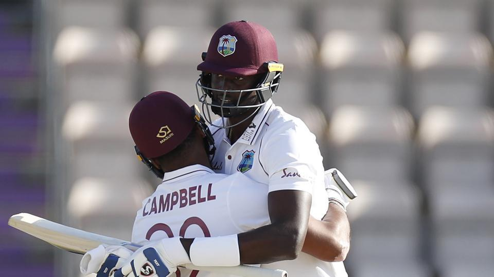 Southampton : West Indies captain Jason Holder, right, hugs teammate John Campbell after their win on the fifth day of the first cricket Test match between England and West Indies, at the Ageas Bowl in Southampton, England, Sunday, July 12, 2020.
