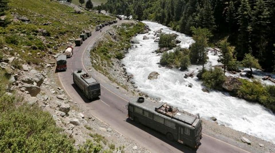 An Indian Army convoy moves along a highway leading to Ladakh, at Gagangeer in Kashmir's Ganderbal district on June 18, 2020.