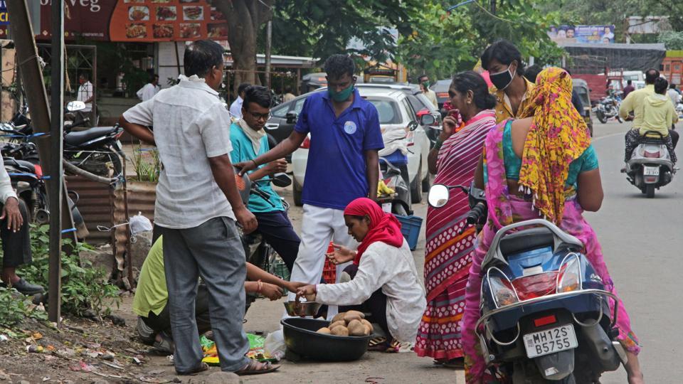 People purchasing vegetables on road near Katraj breaking the social distancing in Pune, India, on Saturday, July 11, 2020.