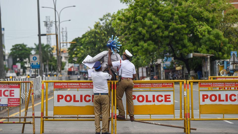 Chennai: Traffic police personnel block a road during lockdown as a preventive measure against the spread of coronavirus disease.