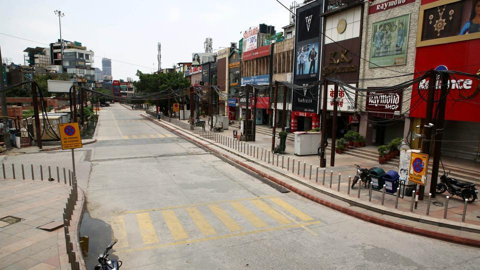 A deserted view of Noida sector-18 market during the total lockdown imposed by the state government for three consecutive days due to surge in Covid-19 cases, in Noida.