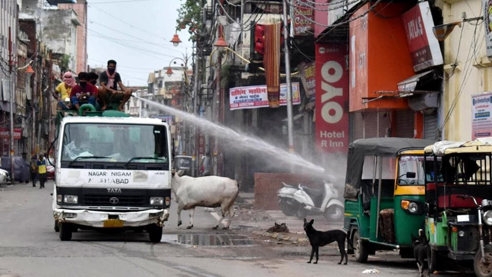 Municipal workers sanitize a market during the lockdown in an attempt to contain the spread of the coronavirus disease in Prayagraj on Sunday. (ANI Photo)