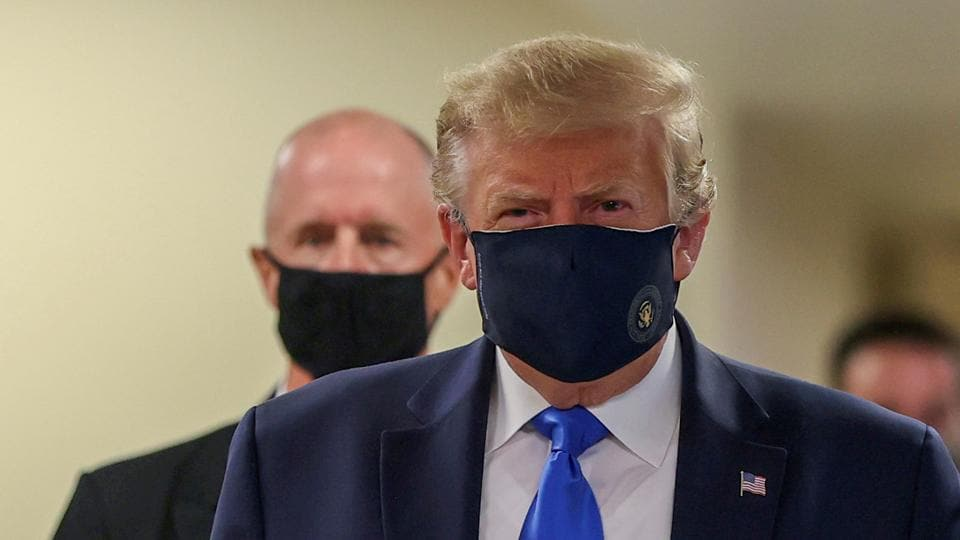 President Donald Trump wears a mask while visiting Walter Reed National Military Medical Center in Bethesda, Maryland,US.