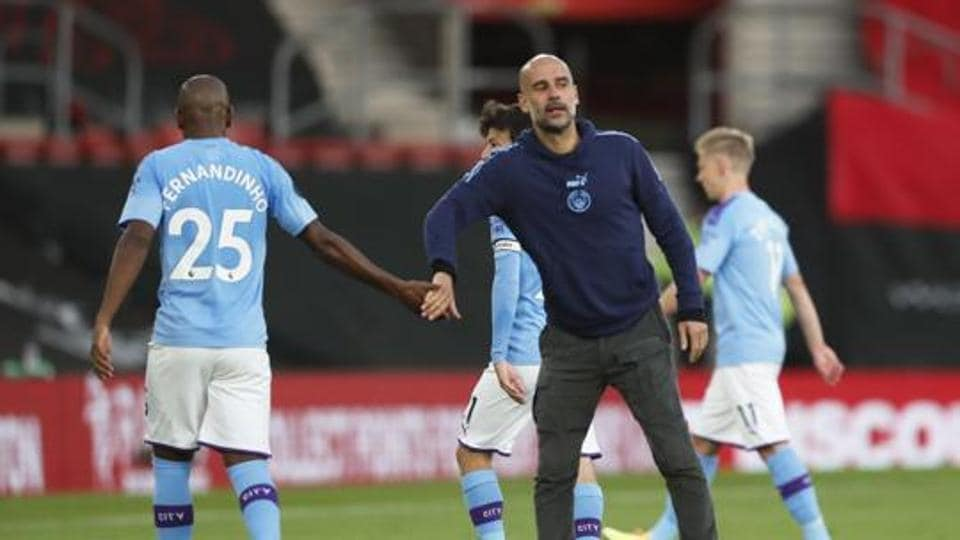 Manchester City manager Pep Guardiola and Fernandinho after the match.