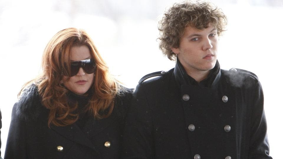Lisa Marie Presley with Benjamin Keough at a ceremony commemorating Elvis Presley's 75th birthday. (AP Photo/Mark Humphrey, File)