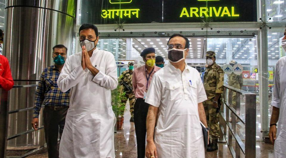 Senior Congress leaders Randeep Surjewala and Ajay Maken arrive at Jaipur airport on Sunday.