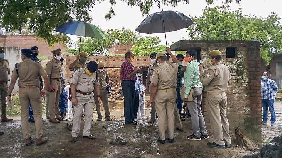 A Special Investigation Team visits the Bikru village, where eight policemen were killed by gangster Vikas Dubey on July 3, for investigation into the case, in Kanpur on Sunday.