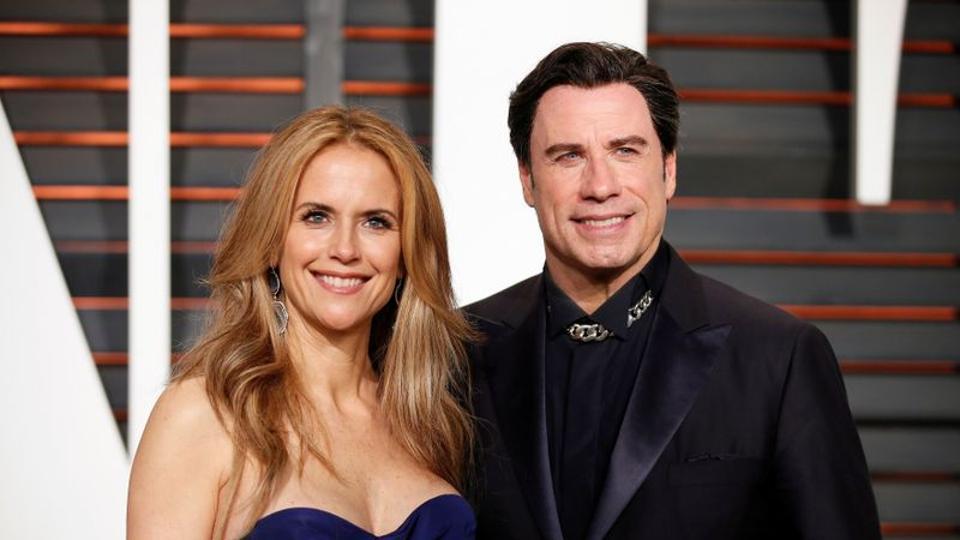 Kelly Preston and husband, actor John Travolta, arrive at the 2015 Vanity Fair Oscar Party in Beverly Hills, California February 22, 2015.