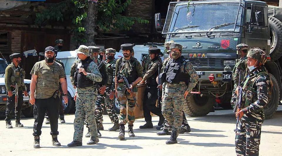 Army personnel rush toward encounter site in Hardshiva village of north Kashmir's Sopore.