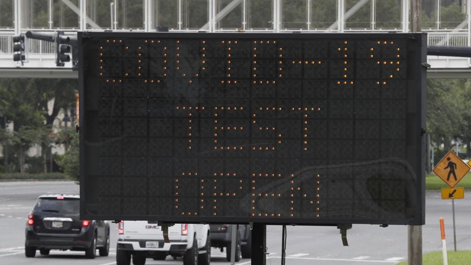 An electronic sign directs motorists to a drive up Covid-19 testing site at the Orange County Convention Center on Sunday in Orlando, Fla.