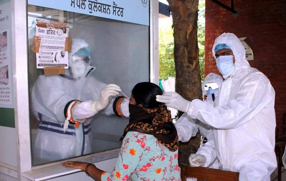 A swab sample being collected for testing. Besides the ortho department of the Guru Gobind Singh Medical College and Hospital, the OPD and cath lab have been closed, while the medical superintendent is also quarantined as he was in contact with positive patients.