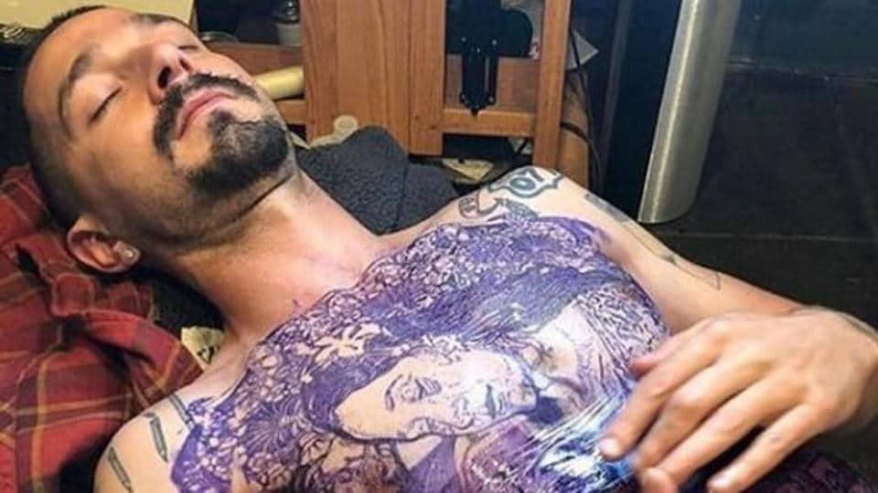 Shia LaBeouf gets tattooed.