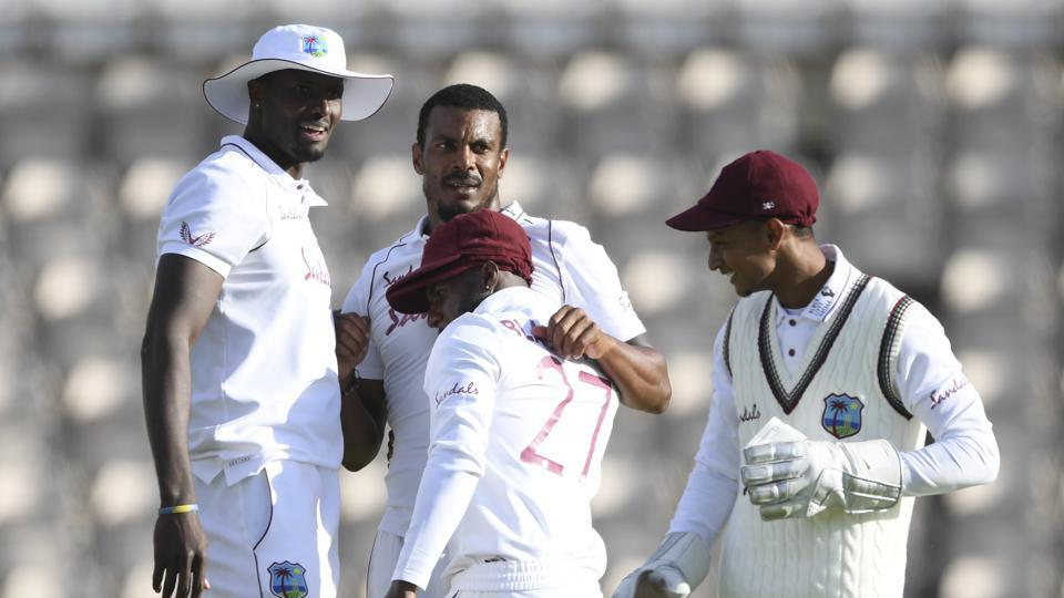 West Indies' Shannon Gabriel, second left, celebrates with teammates the dismissal of England's Ollie Pope during the fourth day of the first cricket Test match between England and West Indies, at the Ageas Bowl in Southampton, England, Saturday, July 11, 2020. (Mike Hewitt/Pool via AP)