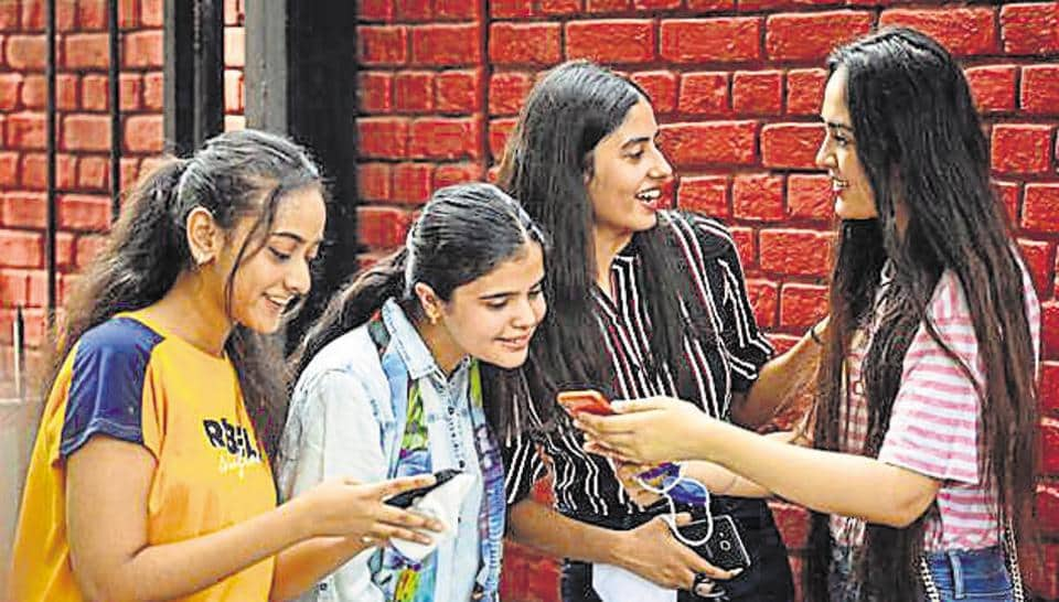 A group of students check the results of the CBSE Class 12 boards examinations at St. Thomas' Girls Senior Secondary School at Mandir Marg in New Delhi, India, on Monday, July 13, 2020. (Photo by Sanchit Khanna/ Hindustan Times)