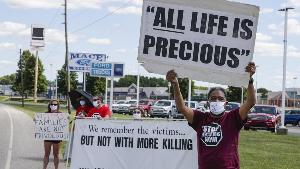 Protesters against the death penalty gather in Terre Haute, Ind., Monday, July 13, 2020.  Daniel Lewis Lee, a convicted killer, was  executed at the federal prison in Terre Haute,by lethal injection  at the federal prison in Indiana.