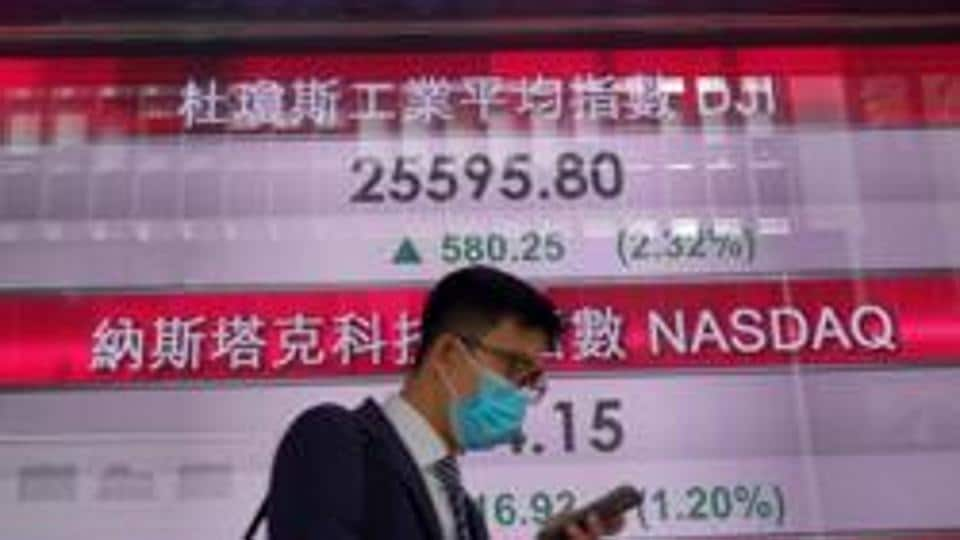 Asian markets hit by new lockdowns, fresh China-US tensions