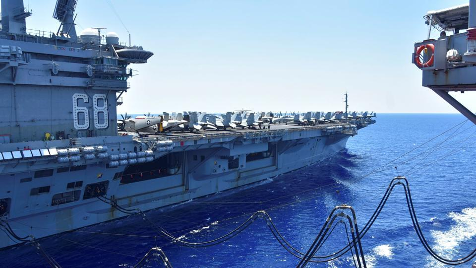 The US Navy aircraft carrier USS Nimitz receives fuel from the Henry J Kaiser-class fleet replenishment oiler USNS Tippecanoe during an underway replenishment in the South China Sea on July 7.