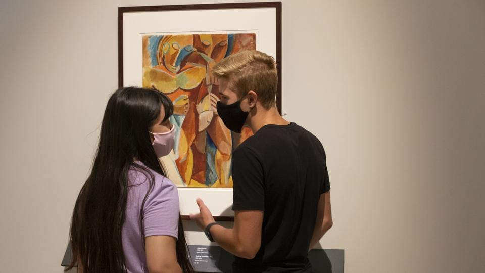 Visitors wearing face masks to protect against coronavirus, stand by Pablo Picasso's art work Friendship II at the exhibition From Durer to Matisse Selected drawings from the collection of the Pushkin State Museum of Fine Arts in Moscow, Russia. (AP PHOTO/Alexander Zemlianichenko Jr)