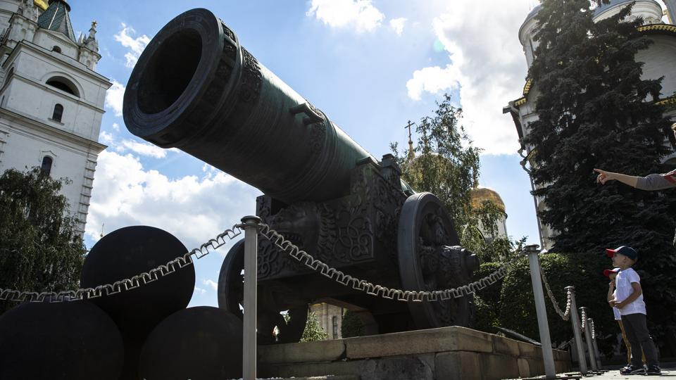 Children look at the Tsar Cannon in the Kremlin in Moscow, Russia, Friday, July 10, 2020.  (AP)
