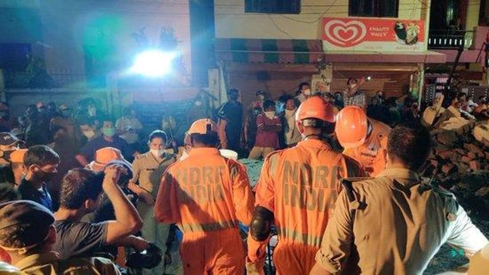 NDRF personnel trying to rescue people from under the debris of the building which collapsed in Dehradun on Tuesday night.