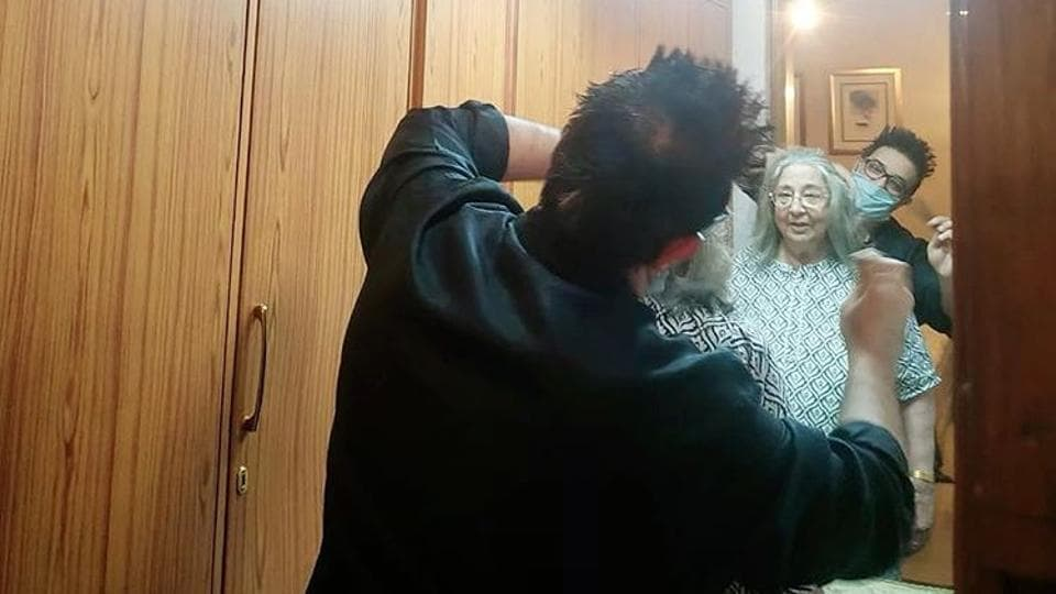 Designer Suneet Varma took to Instagram to share this photo of  him giving a haircut to his mother Indra Varma.