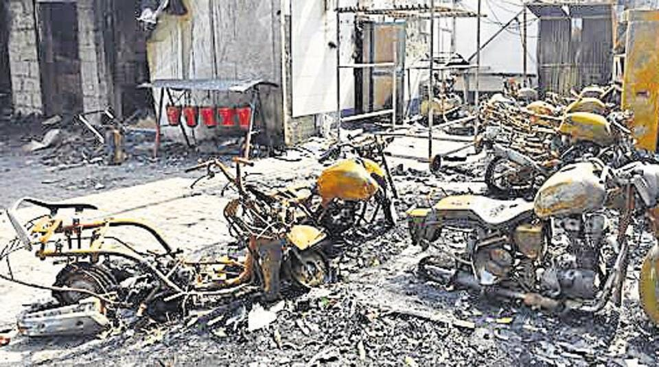 Burnt petrol pump after the riots at Bhajanpura, in New Delhi on March 1, 2020.