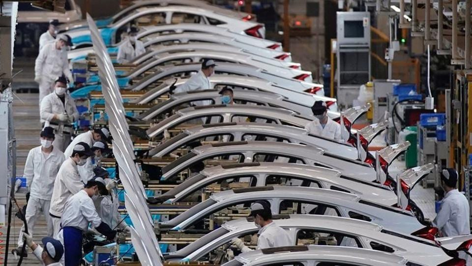 Employees work on a production line inside a Dongfeng Honda factory after lockdown measures in Wuhan, the capital of Hubei province and China's epicentre of the novel coronavirus disease outbreak.