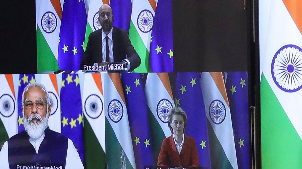 European Council President Charles Michel, Ursula von der Leyen and Indian Prime Minister Narendra Modi are seen on the monitor as they take part in a virtual summit, in Brussels, Belgium.