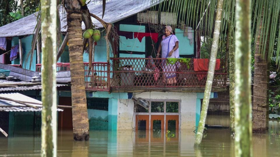 Nagaon: A woman marooned in her house in the flood-hit Baghmari village in Nagaon district of Assam.
