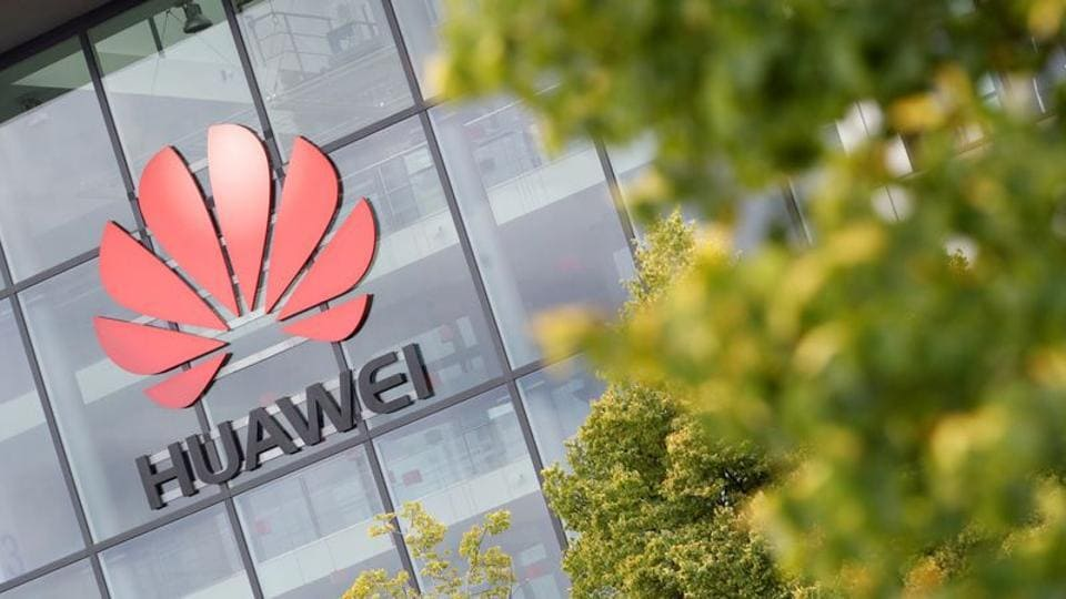 Huawei logo is pictured on the headquarters building in Reading, Britain.