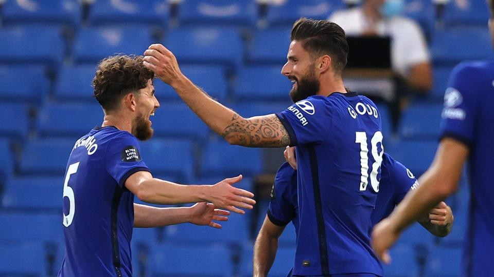 Chelsea's Olivier Giroud celebrates scoring their first goal with teammates.
