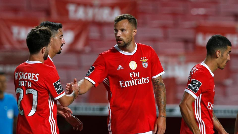 Benfica's Haris Seferovic celebrates scoring their second goal with teammates.