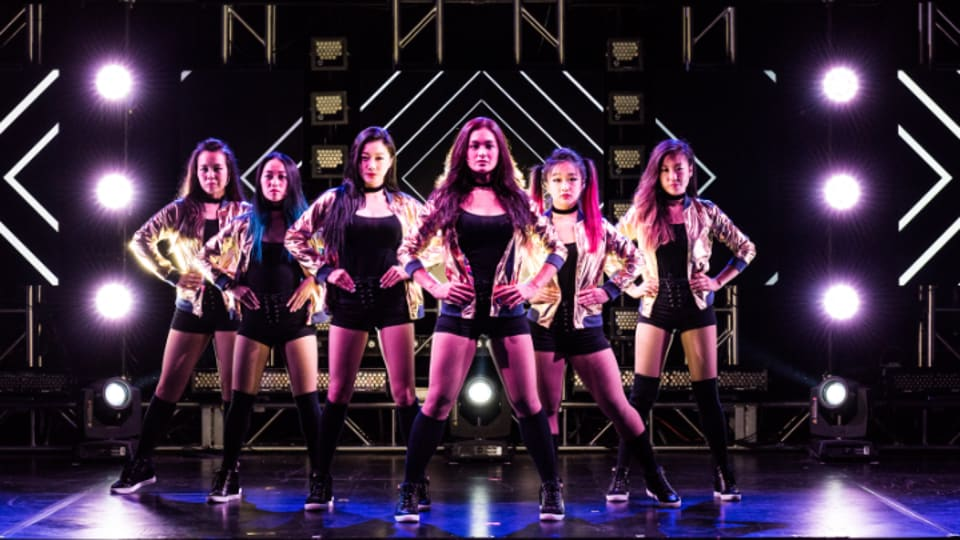 Interested performers are being asked to send a video of themselves singing a pop or K-pop song and a clip of their dance moves. (A still from the show)