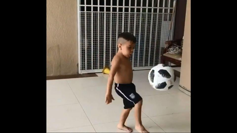 The image shows the kid with a football.