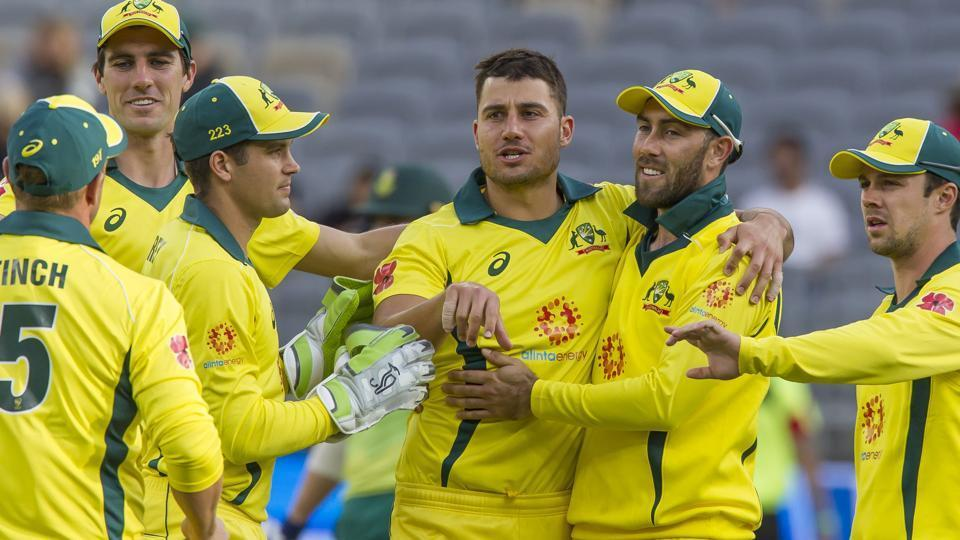 Australia's Marcus Stoinis (C) celebrates with teammates after