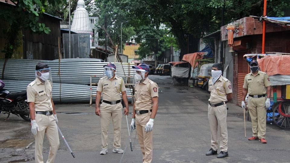 Police personnel stand guard at a containment zone in Pune on July 15. The number of Covid active cases reported by the state and the district administration shows a difference of at least 10,000.