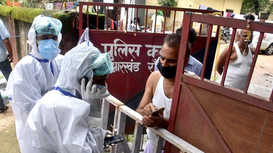 Jharkhand, July 14 (ANI): Health Workers wearing PPE Kit taking police personnel who found corona virus-positive to the COVID centre from Police Club and Police Association in Ranchi on Tuesday. (ANI Photo)