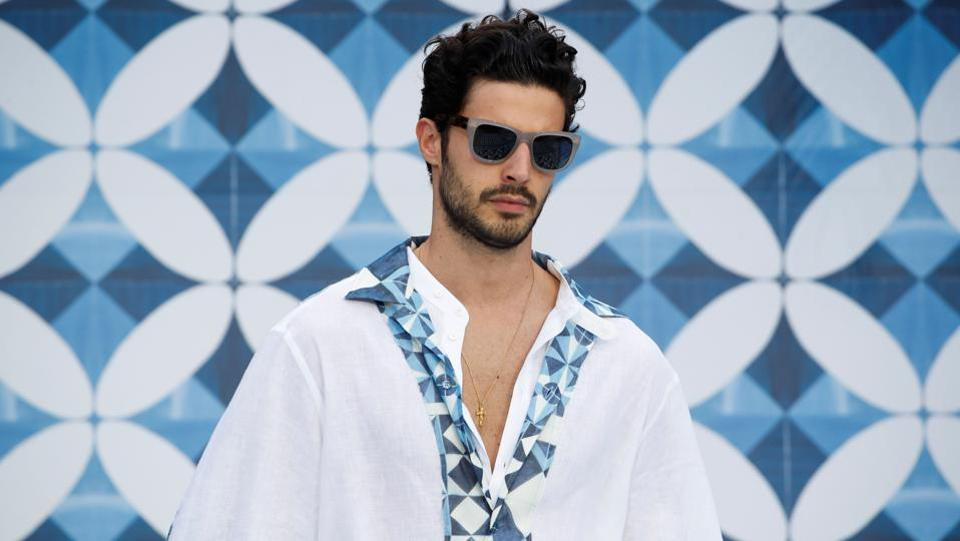 A model presents a creation from the Dolce & Gabbana Spring/Summer 2021 men's collection, which drew inspiration from the Parco dei Principi de Sorrente hotel, which is on the coast south of Naples, in a live-streamed show at the university campus of the Humanitas Research Foundation in one of the first physical fashion shows since the coronavirus disease (COVID-19) outbreak, during Milan Digital Fashion Week in Rozzano, south of Milan, Italy, July 15, 2020.  (REUTERS)